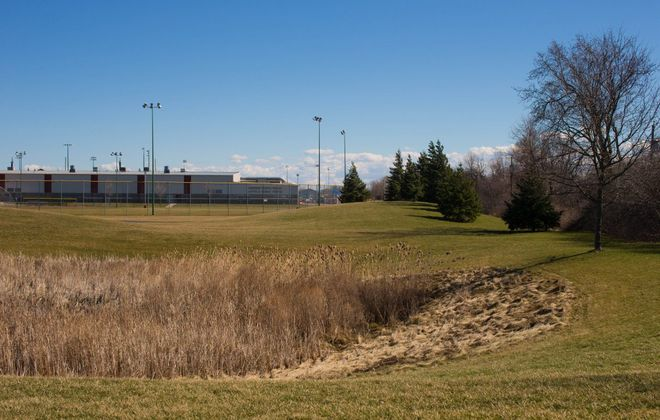 Park land next to the Northtown Center on Amherst Manor Drive where Uniland plans to construct a Hampton by Hilton hotel. The Amherst Planning Board tabled its reivew of the project site plan at its March board meeting. (News file photo)
