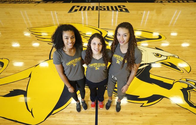 Canisius volleyball players Tamia Bowden, left, Sara Wesley, center, and Leah Simmons, right, at the Koessler Athletic Center (Photo: Mark Mulville/Buffalo News)