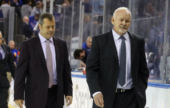 There have already been several slow walks off the ice this season for Rangers coach Alain Vigneault (left) and new assistant Lindy Ruff. (Getty Images)