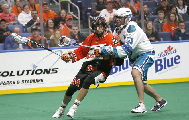 Bandits' Mitch Jones tries to shake Rochester's Adam Bomberry in front of the goal as the Buffalo Bandits play the Rochester Nighthawks at KeyBank Center on Friday, March 3, 2017. (Robert Kirkham/Buffalo News)
