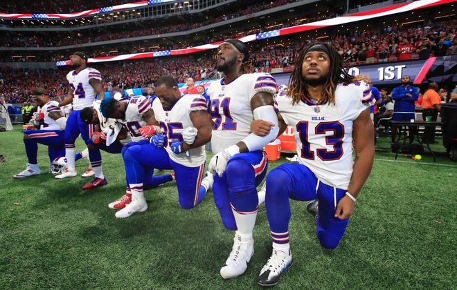 Six Buffalo Bills players kneel during the national anthem before the Oct. 1, 2017, game vs. the Atlanta Falcons at Mercedes-Benz Stadium in Atlanta. (Harry Scull Jr./News file photo)