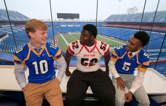 Matt Myers of West Seneca West, Jeremiah Sanders of South Park and Juston Johnson of West Seneca West hang out together during Section VI football media day Tuesday at New Era Field's press box. (Harry Scull Jr./Buffalo News)