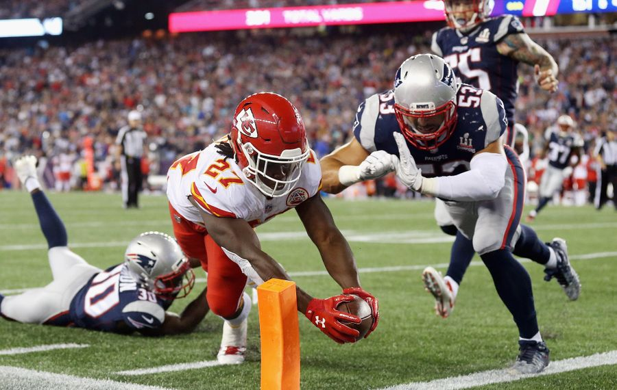 Kareem Hunt of the Kansas City Chiefs dives for the pylon to score a 4-yard rushing touchdown during the fourth quarter against the New England Patriots at Gillette Stadium on Sept. 7, 2017, in Foxboro, Mass.  (Getty Images)