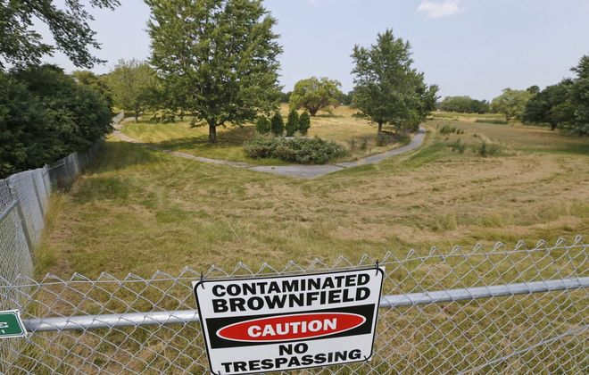 A sign on the security fence near the old Westwood Country Club on North Forest in Amherst. (Robert Kirkham/Buffalo News file photo)