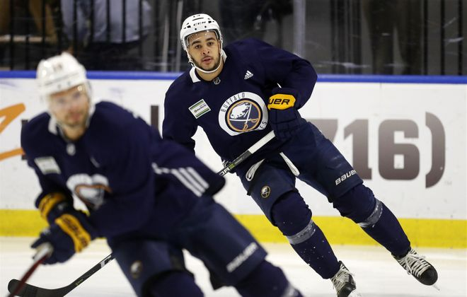 Nick Baptiste, in the background, hopes improved all-around play can move him to the foreground with Buffalo. (Mark Mulville/News file photo)