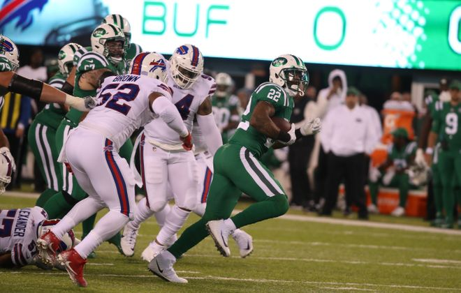 Preston Brown (52) chases Jets running back Matt Forte. (James P. McCoy/Buffalo News)