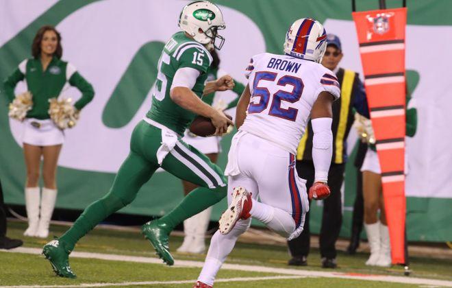 Josh McCown scrambles to get away from the Bills' Preston Brown (James P. McCoy/Buffalo News)