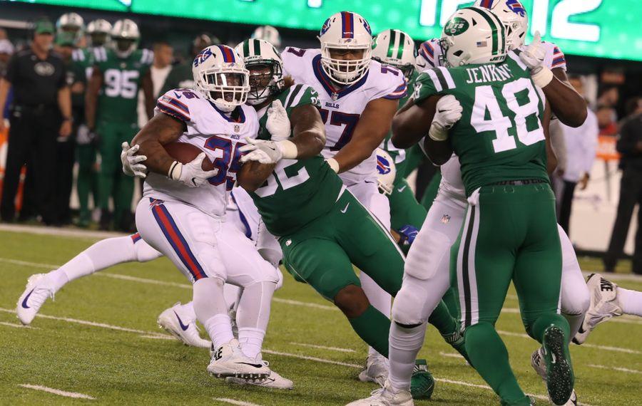 Bills back Mike Tolbert is swarmed. (James P. McCoy/Buffalo News)
