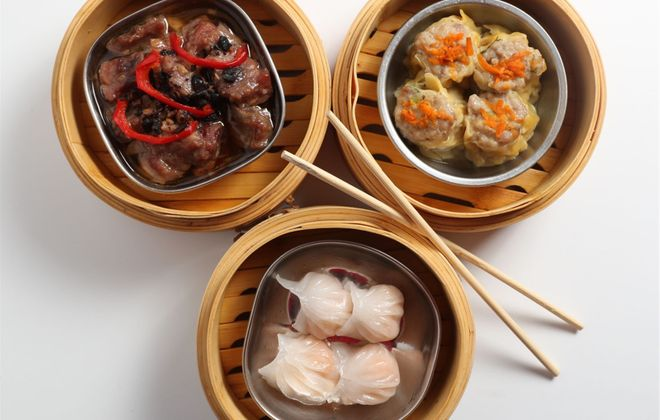 At 007 Chinese Food in the West Side Bazaar, you can order dim sum dumplings like shumai (upper right), har gow (lower), and braised spare ribs with black beans. (Sharon Cantillon/News file photo)