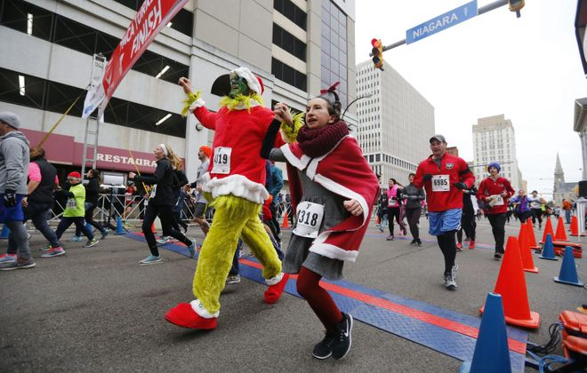 Runners cross the finish line during the 122nd annual YMCA Turkey Trot last Thanksgiving. This year's race starts at 9 a.m. on Nov. 22. (Mark Mulville/News file photo)