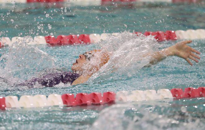 Riley Drummond of Fredonia won the 100 yard backstroke in a time of 57:66. (Sharon Cantillon/Buffalo News)