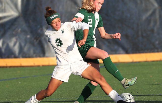 Marisa Warren, of Nichols, left and Brigid Molloy, of Nardin fight over the ball. (Sharon Cantillon/Buffalo News)
