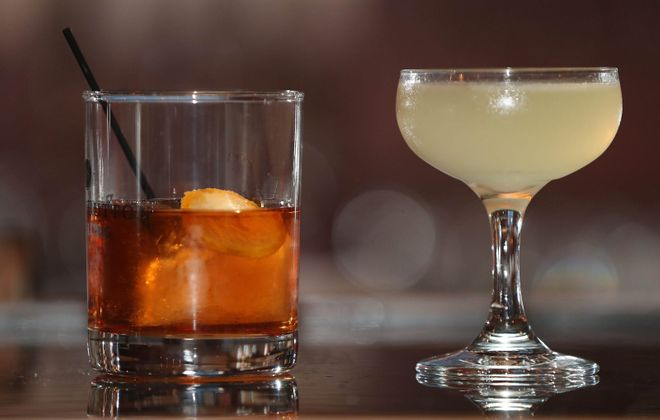 The Old Fashioned and The Bees Knees, served at Black Button Distillery, are made with liquor from their distillery. (Sharon Cantillon/Buffalo News)