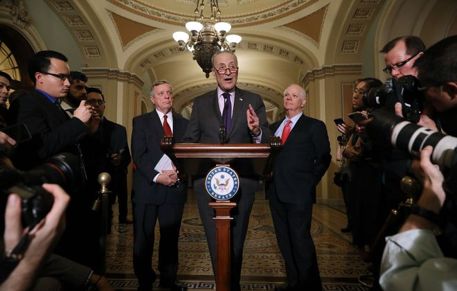 Senate Minority Leader Charles Schumer (D-NY) is joined by Senate Minority Whip Dick Durbin (D-IL) and Sen. Ben Cardin (D-MD) on Nov. 28, 2017, in Washington, D.C. (Getty Images)