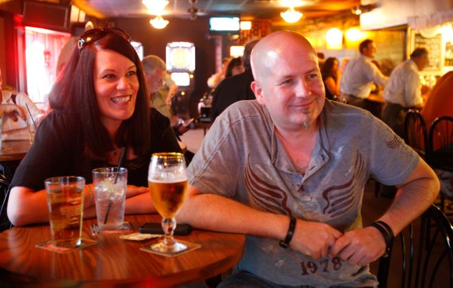 Kelly and Jay Medynski listen to the Big Sauce Trio performing at Alternative Brews in 2013. A doctor has paid $450,000 for the property, where he will move his practice. (Harry Scull Jr./News file photo)