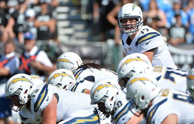 Philip Rivers #17 of the Los Angeles Chargers goes under center against the Oakland Raiders during their NFL game at Oakland-Alameda County Coliseum on October 15, 2017 in Oakland, California.  (Photo by Don Feria/Getty Images)
