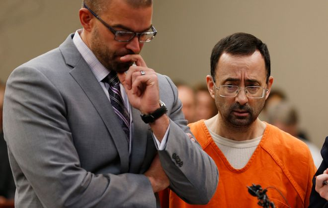 Former Michigan State University and USA Gymnastics doctor Larry Nassar (R) listens to the court with his defense attorney Matt Newberg  in Ingham County Circuit Court Wednesday , 2017 in Lansing, Mich.  (Getty Images)