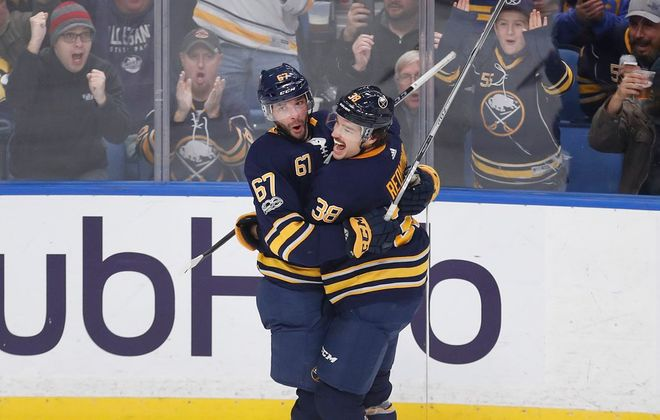 Benoit Pouliot (67) earned adoration from Sabres defenseman Zach Redmond and the fans after his goal Tuesday. (Mark Mulville/Buffalo News)