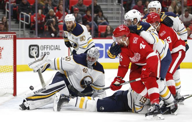 Detroit's Luke Glendening beats Sabres goalie Robin Lehner with a backhand for the game's first goal (USA Today Sports)