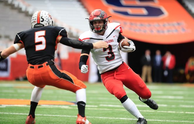 Maple Grove's Nick Fabrizio looks for an opening against Cambridge's Tyler Linendoll during Friday afternoon's state Class D football final at the Carrier Dome in Syracuse. (Harry Scull Jr./Buffalo News)