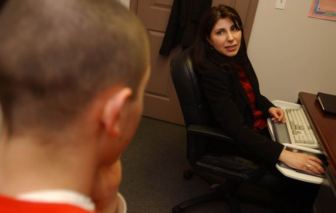 Addiction Counselor Renee Bosi counsels a young man in her office at Horizon Health Services in Niagara Falls. in this file photo. The organization is moving its  administrative offices from Bailey Avenue in Buffalo to Dodge Road in Amherst. (News File Photo)