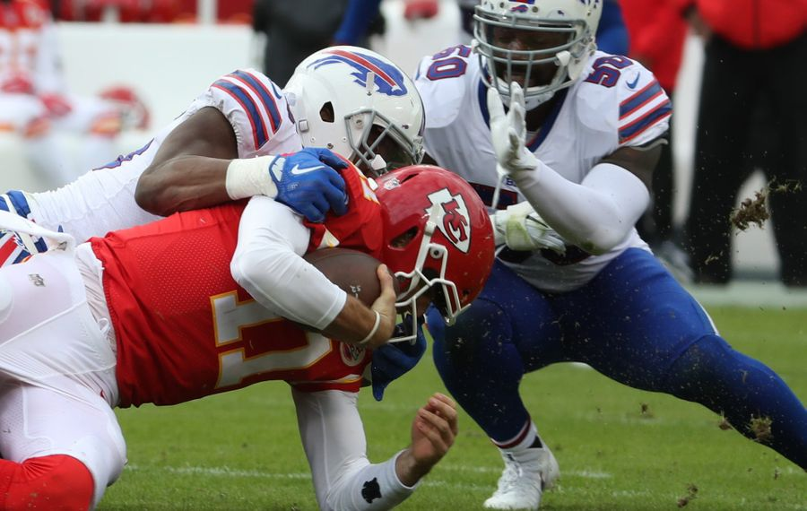 Jerry Hughes tackles Alex Smith. (James P. McCoy/Buffalo News)