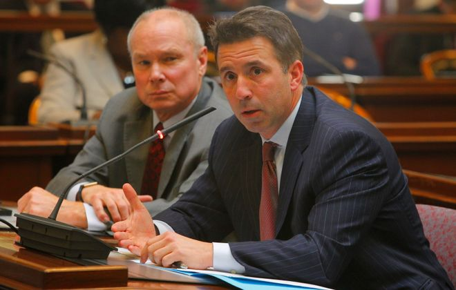 Bill Munson, Bills' Senior Vice President of Government Relations and External Affairs, left, appears with Bills President and Chief Executive Officer  Russ Brandon,  at a 2013 meeting of the Erie County Legislature's economic development commitee to answer questions about the proposed lease for Ralph Wilson Stadium. (John Hickey/Buffalo News file photo)
