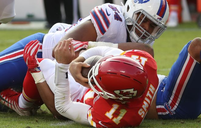 Buffalo Bills outside linebacker Lorenzo Alexander (57) sacks Kansas City Chiefs quarterback Alex Smith (11) in the third quarter at Arrowhead Stadium.  (James P. McCoy / Buffalo News)