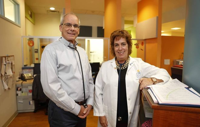 Drs. Michael Heimerl and Dr. Colleen Mattimore lead the new Medical Health Associates, a collection of eight offices in Erie County with a combined work force of 50 health professionals and 200 support staff.  (Mark Mulville/Buffalo News)