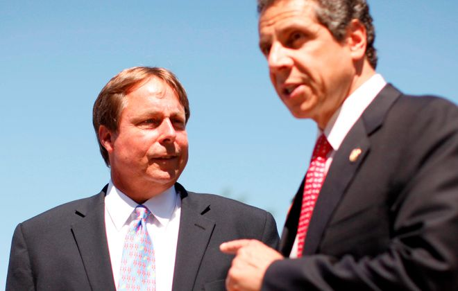 A federal judge in Manhattan has dismissed claims against Gov. Andrew M. Cuomo and New York State by a Buffalo woman who said she was sexually harassed by local economic development chief Sam Hoyt. (News file photo)