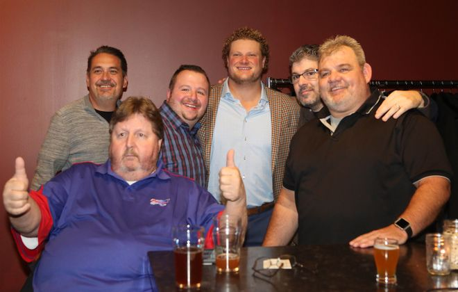 Bills center Eric Wood mingled with fans at his Flights and Bites fundraiser on Monday night. The Eric Wood Fund raised $57,000 for The Children's Hospital of Buffalo Foundation and Stone's Buddies. (Dave DeLuca/Special to The News)