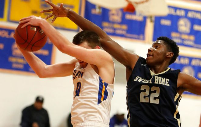 Sweet Home's DaeQuan Hill fights for a rebound with Alden's Maxwell Gilbert during the Greg D. Martin Tip-Off Tournament at Iroquois. The Panthers won, 72-58. (Mark Mulville/Buffalo News)