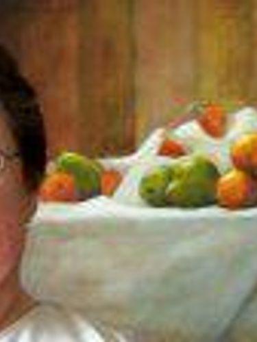 Pat Sciandra with one of her paintings. (Photo courtesy the Sciandra family.)