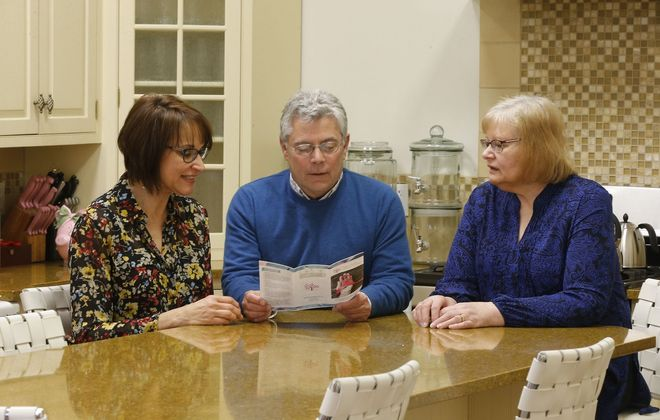 """Rob Jones, center, executive director of Breast Cancer Network of WNY, is among those involved with the planning of a free seminar this week entitled, """"Sexuality and Intimacy after Breast Cancer."""" He is pictured with survivors Bev Jasinski, right, and Debbie Malarkey, left, at the nonprofit's headquarters in the Bella Moglie Building on Walden Avenue in Depew. (Robert Kirkham/News file photo)"""