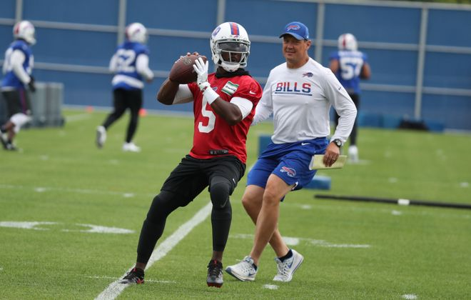 Offensive coordinator Rick Dennison works with quarterback Tyrod Taylor during a November practice. (James P. McCoy/News file photo)