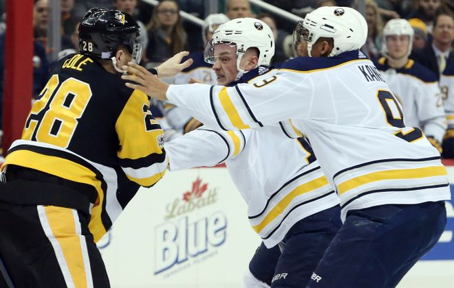 The Sabres' Evander Kane and Jack Eichel go after Pittsburgh's Ian Cole after he dropped Sam Reinhart with a hard hit Tuesday. (USA TODAY Sports)