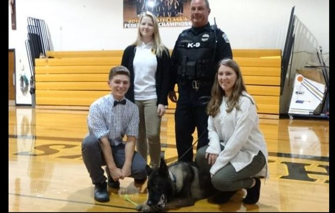K-9 Shield comes to Cardinal O'Hara High School. Students (l-r)  Kal Klis, Allyson Nemeth and Alyssa Kolcz , present a $1,000 check to  ATF Agent Gerry O'Sullivan and Shield to honor Buffalo  K-9 Officer Craig Lehner.