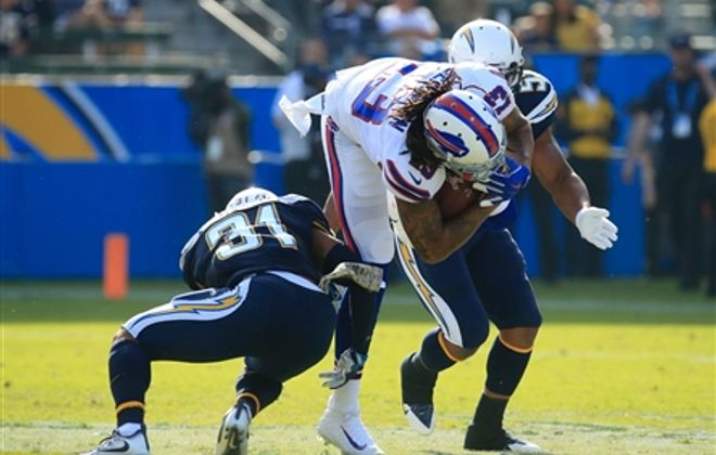 Bills receiver Kelvin Benjamin was hurt on this play Sunday in the first quarter against the Los Angeles Chargers. (Harry Scull Jr./Buffalo News)