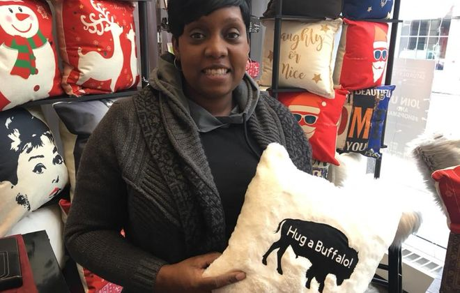 Tracey Huggins has a trove of affordably priced home decor gifts at Queen City Pop-Up. (Samantha Christmann/Buffalo News)