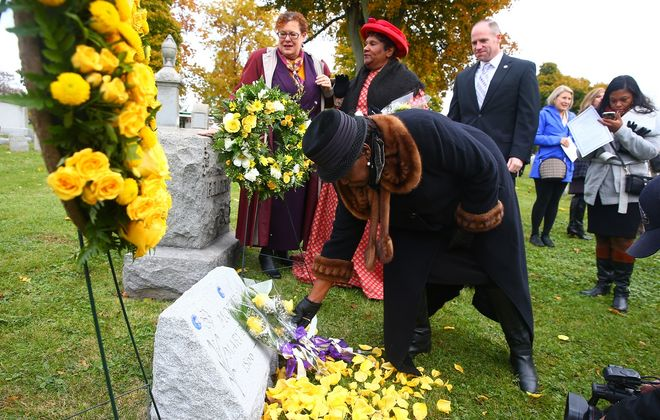 Assemblywoman Crystal Peoples-Stokes placed flowers at the grave of Mary Burnett Talbert on Tuesday morning in Forest Lawn. (John Hickey/Buffalo News)