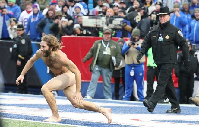 A Bills fan later identified as Tristan Lambright runs out on the field during the fourth quarter of the Saints' blowout of the Bills. (James P. McCoy/News file photo)