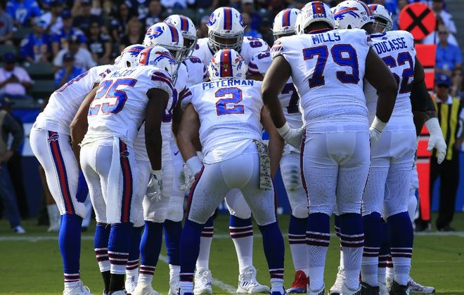 Nathan Peterman talks to the offense in a huddle. (Harry Scull Jr./News file photo)