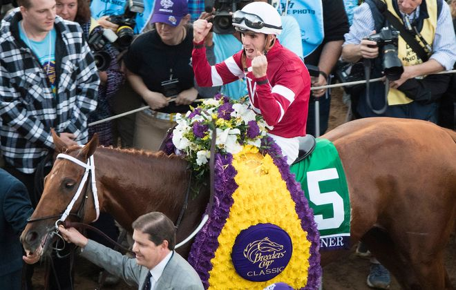 DEL MAR, CA: Florent Geroux, aboard Gun Runner #5, celebrates after winning the Breeders' Cup Classic  (Photo by Ting Shen/Eclipse Sportswire/Breeders Cup)