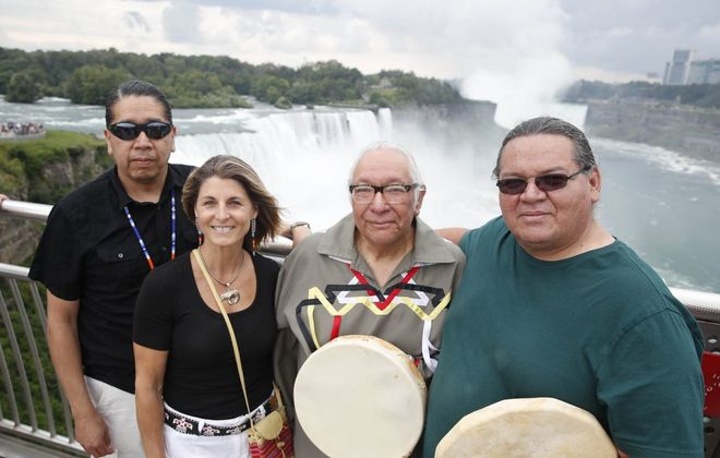 """Drums were used to call and reply across the Niagara gorge at the Prospect Point Observation Tower as part of a live concert inspired by the documentary """"Rumble: The Indians Who Rocked the World."""" From left are Gary Parker (Seneca), Michele-Elise Burnett (Metis), Allan Jamieson (Cayuga), and Philip Davis (Mohawk). Burnett had the idea for the drum communication across the gorge before the free live concert in Oakes Garden Theatre on the Canadian side. (Sharon Cantillon/Buffalo News file photo)"""