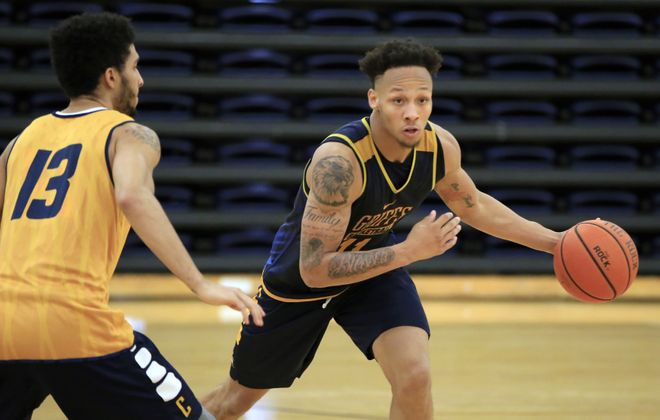 Takal Molson had a game-high 24 points for the Griffs. (Harry Scull Jr./News file photo)