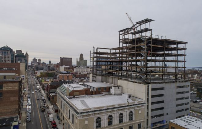 500 Pearl Street, a 12-story mixed-use structure connected to the former Buffalo Christian Center, is under construction.  (Derek Gee/Buffalo News)
