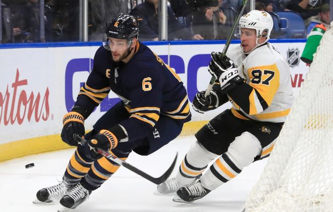 Sabres defenseman Marco Scandella faces the opponents' best, including Pittsburgh's Sidney Crosby. (Harry Scull Jr./Buffalo News)