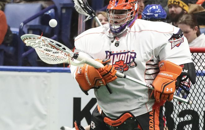 Buffalo Bandits goalie Alex Buque makes a save in the second period of the home opener at Key Bank Center in Buffalo,N.Y. on Friday, Dec. 8, 2017.  (James P. McCoy / Buffalo News)