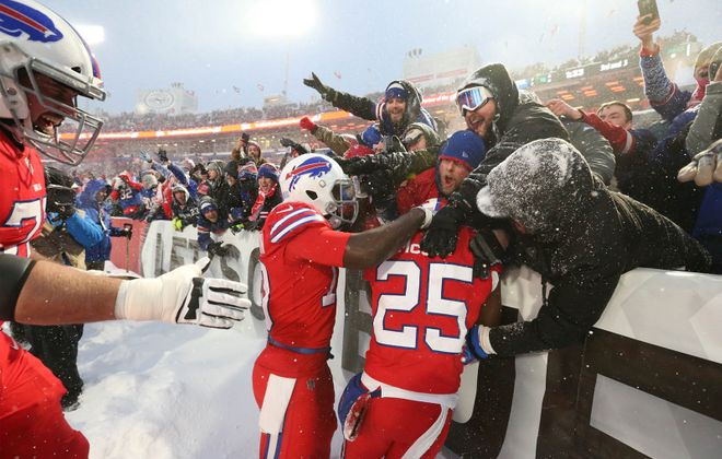 LeSean McCoy celebrates with Bills fans after their overtime win against the Colts. (James P. McCoy/Buffalo News)