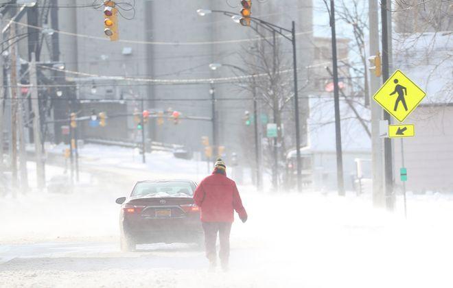 A pedestrian walks down Louisiana Street in Buffalo on a cold, blustery Christmas morning Monday. (Sharon Cantillon/Buffalo News)